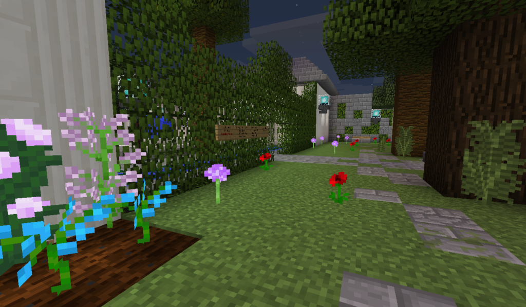 A Minecraft garden room with pink flowers and a grassy path.