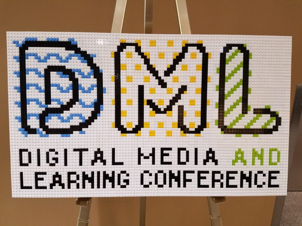 photo of a sign with lego texture that reads, DML Digital Media and Learning Conference