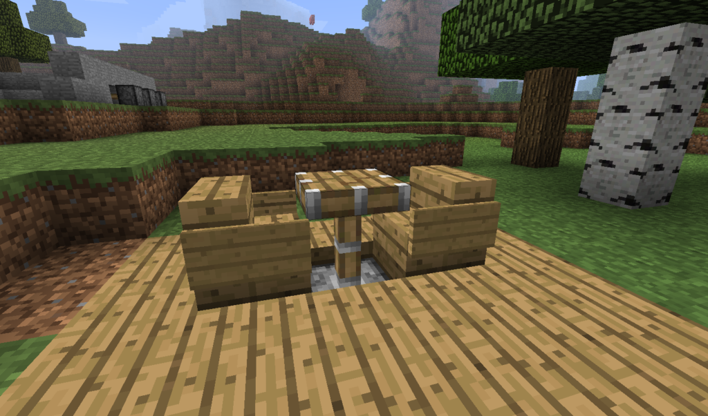 A piston table with two chairs in Minecraft on a wooden floor.